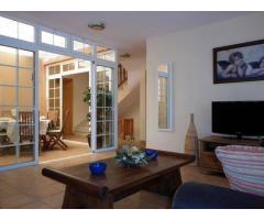 The villa is located in a private urbanization of La Caleta in Costa Adeje - Image 2