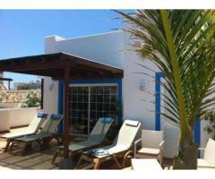 The villa is located in a private urbanization of La Caleta in Costa Adeje - Image 4