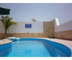 The villa is located in a private urbanization of La Caleta in Costa Adeje - Image 6