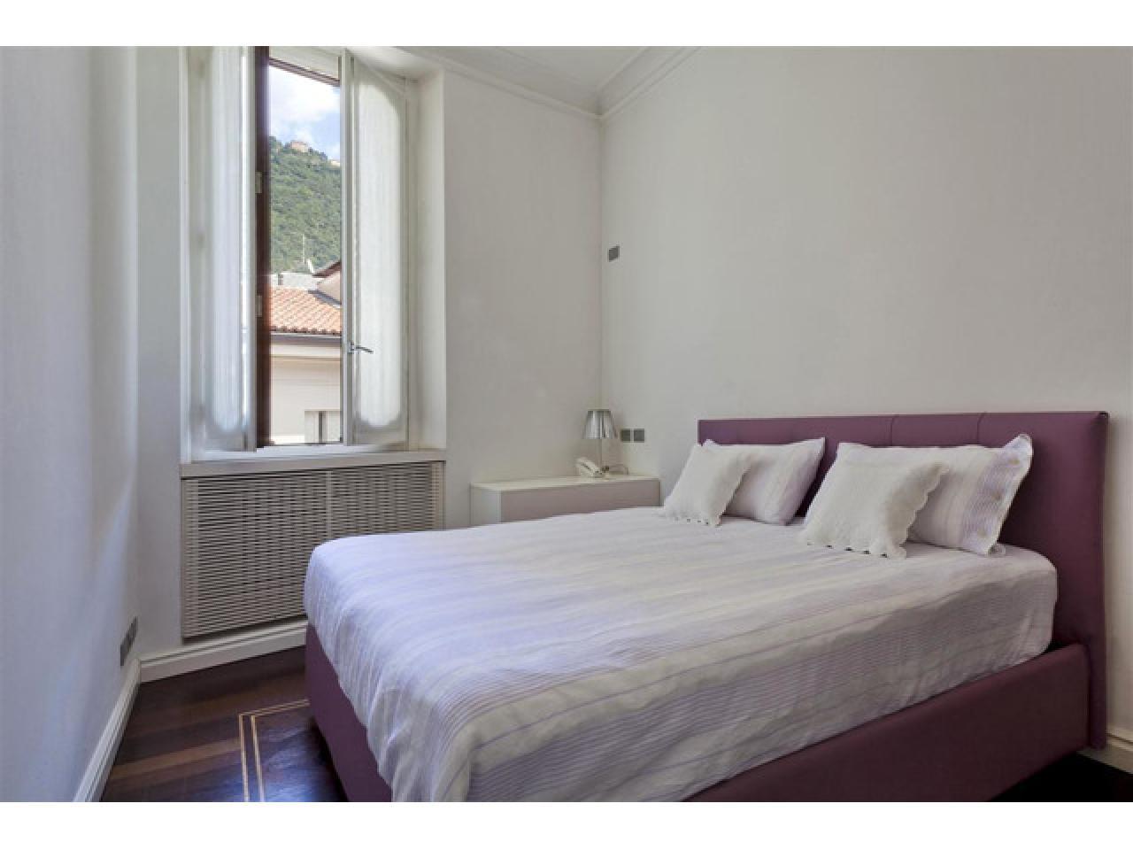 Апартаменты в старинном особняке в историческом центре города Комо (Италия) - 11